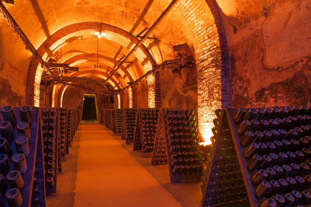 http://www.dreamstime.com/royalty-free-stock-images-champagne-cellars-rows-dusty-bottles-reims-cellar-france-image57980339