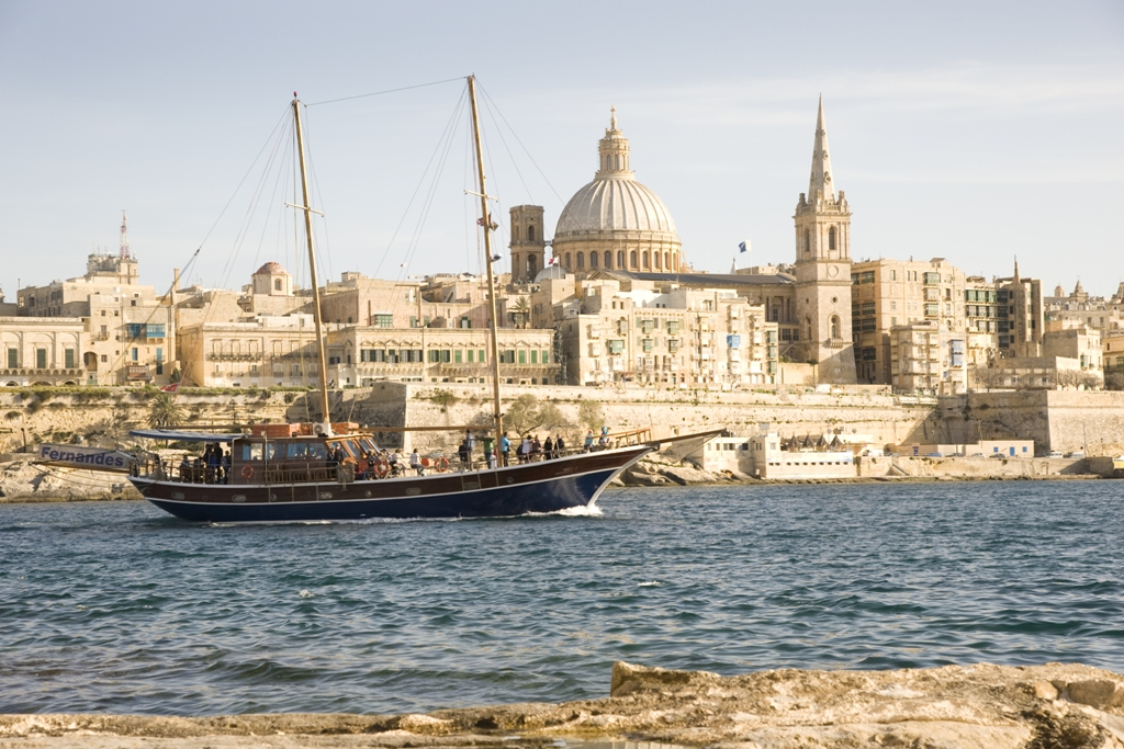 http://www.dreamstime.com/stock-images-turkish-gulet-type-yacht-enters-marsamxett-harbour-against-backdrop-walls-fortified-city-valetta-malta-march-image30182084
